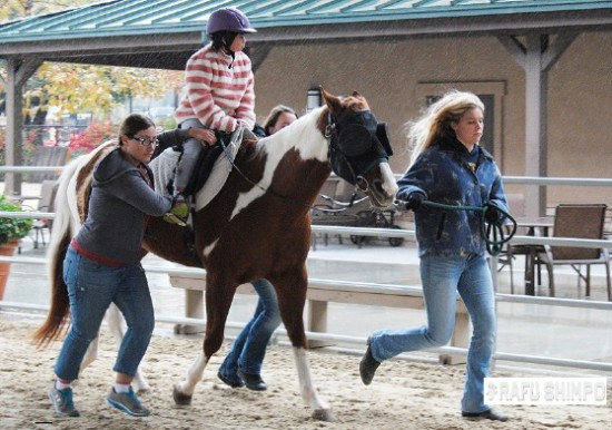 After four years of therapy, Nicole is now able to keep her balance on horseback while going fast.