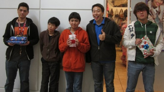 Rising Stars Alumi Michael Taheri (RS 8) and Curtis Takemoto (RS 2 blue shirt) pose with JSPACC buddies at the mall