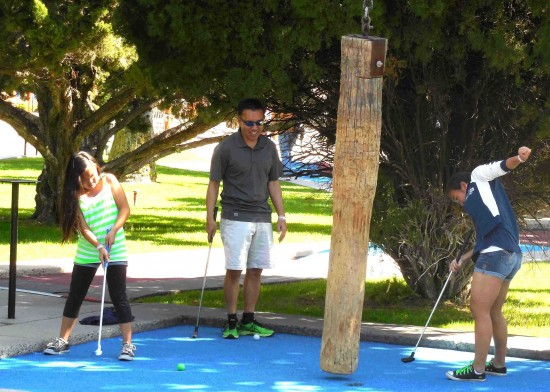 One participant at last year's tournament tries a new putting style.