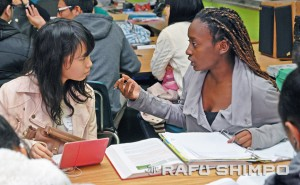 Chinami Ohno, left, listens as Kelsey Verrett explains her homework during her culinary arts class.