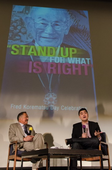 Lloyd LaCuesta (left) in conversation with Juan Antonio Vargas. Behind them is an image of Fred Korematsu with the Presidential Medal of Freedom he received in 1998. (Bob Hsiang Photography)