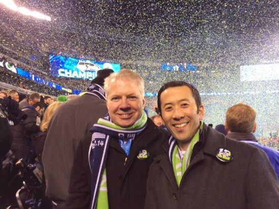 Mayor Ed Murray and husband Michael Shiosaki at the celebration of the Seattle Seahawks' victory over the Denver Broncos in the Super Bowl.