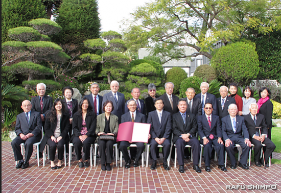 Tak Nishi (front row, center) with family and friends in the garden of the consul general's official residence.