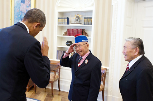 President Barack Obama returns a salute from Tommie Okabayashi, one of the members of a group of Japanese American World War II veterans, during a meeting on Feb. 18 in the Oval Office to congratulate them on their Congressional Gold Medal. (Official White House Photo by Pete Souza)