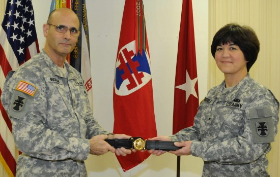 Maj. Gen. William M. Buckler, Jr., commander of 412th Theater Engineer Command, presents deputy commander Brig. Gen. Miyako N. Schanely with her General Officer Belt during her promotion ceremony held at the TEC headquarters in Vicksburg, Miss. (Photo by Capt. Maryjane Falefa Porter, 412th TEC Public Affairs)