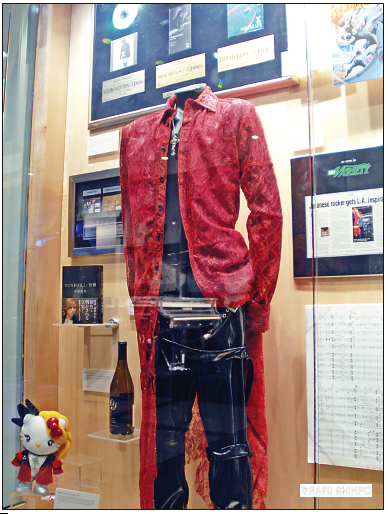 The exhibit at the Grammy Museum includes some of his stage costuming, hand-written scores and a Yoshiki Hello Kitty doll.  (MIKEY HIRANO CULROSS/Rafu Shimpo)