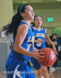 Ayleen Yamaki (5) watches as teammate Morgan Amis sets for a shot. Both players finished with five points.