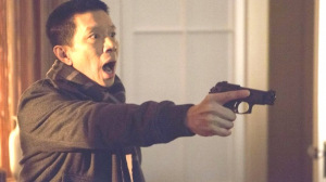 Sgt. Wu (Reggie Lee) reacts in horror when confronting the Aswang.
