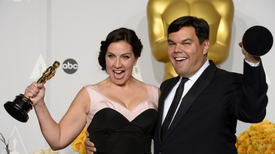 Robert Lopez and his wife Kristen Anderson-Lopez hoist their Academy Awards.