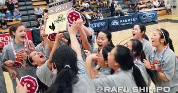 Members of the West Torrance girls basketball team shout with excitement as they hoist the CIF championship plaque, Saturday at Azusa Pacific University. The Warriors captured the first Southern Section title in their program's history with a 65-52 win over El Dorado. (Photos by MIKEY HIRANO CULROSS/Rafu Shimpo)