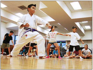 Learning martial arts at Camp Musubi.