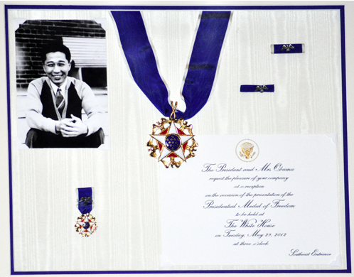 The Presidential Medal of Freedom is mounted along with the accompanying lapel pin and a photo of Gordon Hirabayashi as a young man. (Photo by Sue Misao/NWAW)