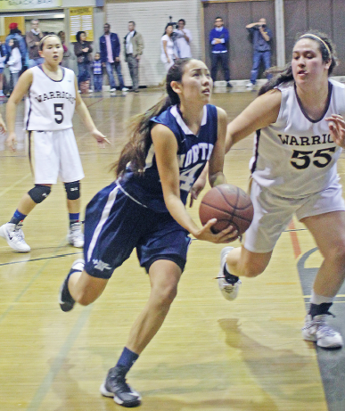 North's McKenna Enomoto drives past Fujioka as Haley Tanabe (5) looks on.