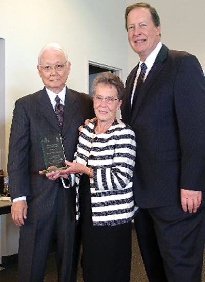 Maderia Bruton, center, receives the Kimi Sugiyama Service Award from Ray Sugiyama and Rev. Steve Wirth.