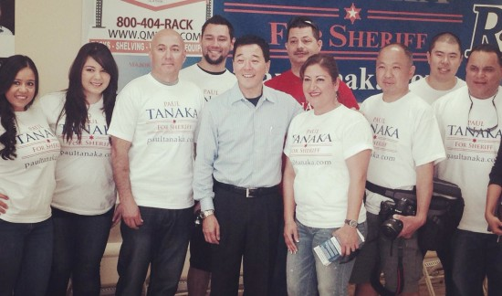 Paul Tanaka (center) with supporters at a campaign event.