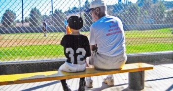 "Wearing a shirt with the words, ""The dream is alive and the quest continues,"" Bob Kodama chats with a young ballplayer. Kodama, a longtime San Fernando Valley coach, passed away March 26. (Photos courtesy Michael Kodama)"
