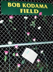 Flowers and messages of condolence are hung at the field named in Kodama's honor.