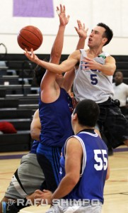 Robbie Young of Grinders drives for a basket in Aye Plus action.