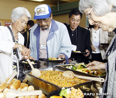 Pictured at the buffet line are Susie and George Yoshinaga, Gardena Mayor Paul Tanaka and Estella Uchizono. (MARIO G. REYES/Rafu Shimpo)