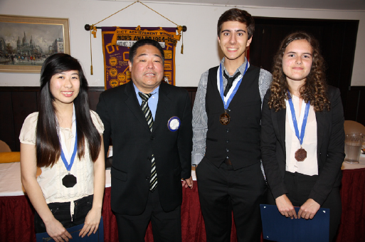 Downtown Magnets High School students won top honors in the recent JAO oratorical contest. From left: Lynie Wong (second place), JAO President Kevin Shimabukuro, Slavi Arnoudov (first place) and Eleanor Skladman (third place).