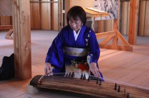 Shirley Muramoto plays koto in the Mess Hall at Manzanar.