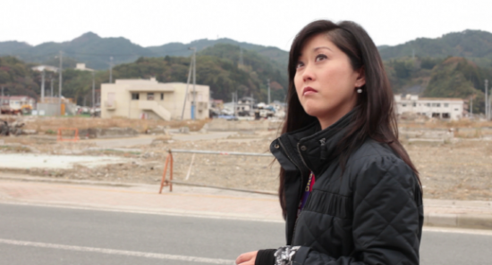 U.S. Olympic gold medalist Kristi Yamaguchi surveying the tsunami damage in Kesennuma.