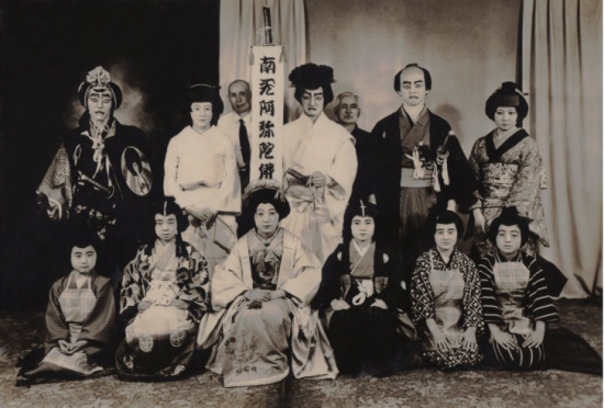 Yukino Okubo Harada and her buyo dance students at Amache/Granada. Katsura (wigs) made by Matsui Suimin, standing left of sign.