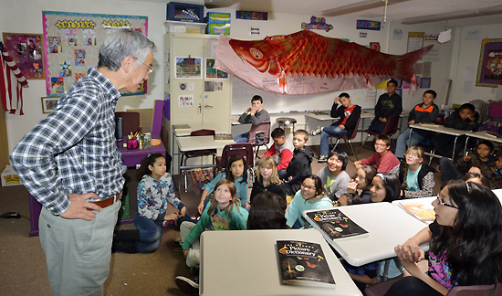 Shishido talks with students at Peak School in Flagstaff, Arizona. (Courtesy of U.g. Kaneko)