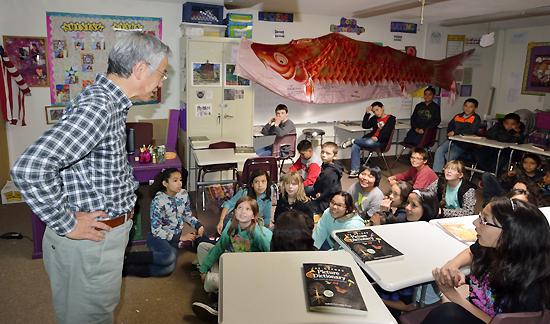 Shishido talks with students at Peak School in Flagstaff, Arizona. (Courtesy of U.g. Kaneko)