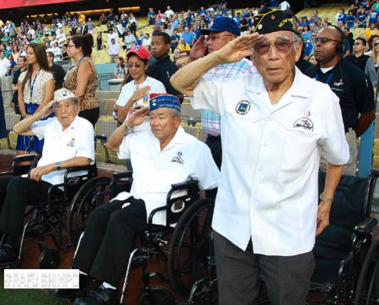 Hitoshi Sameshima salutes during a pregame ceremony at Dodger Stadium in 2013. (MARIO G. REYES/Rafu Shimpo)