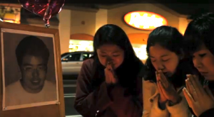 """The two slain students are mourned at the site where they were shot in a scene from """"Lives Interrupted."""""""