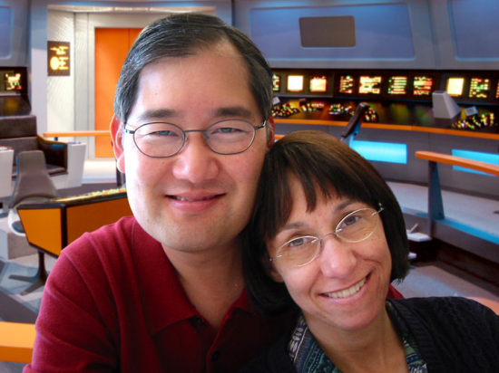 "Michael and Denise Okuda on the set of the ""Star Trek: Enterprise"" two-part episode ""In a Mirror Darkly"" in 2005. Their combined ""Star Trek"" careers include four TV series, seven movies, and the remastering of the original series."