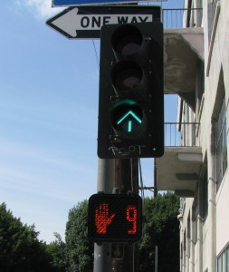 Flashing hand and countdown mean it's not okay to cross.