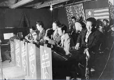 George Yoshida (second from left) playing saxophone with the Music Makers at Poston Camp 1 in 1942.