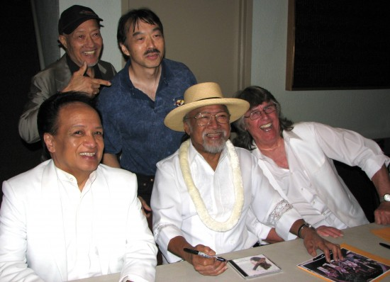 After an Association concert at the Aratani Theatre in April 2013: (seated, from left) band members Del Ramos Larry Ramos and Jim Yester; (standing, from left) Aki Aleong and Guy Aoki of MANAA. (J.K. YAMAMOTO/Rafu Shimpo)At the Aratani concert: Actor Aki Aleong and Guy Aoki with Del Ramos, Larry Ramos, and Jim Yester of The Association.