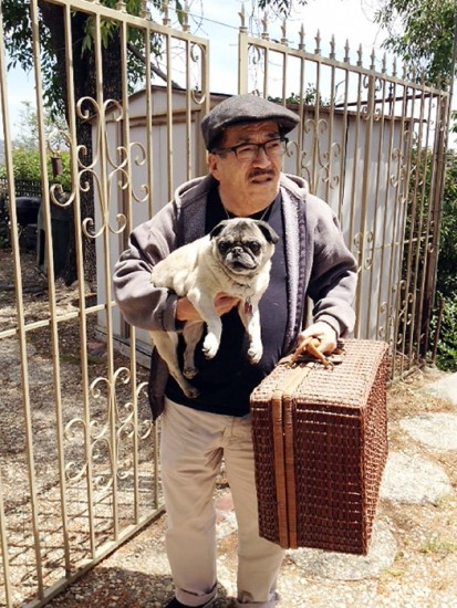 Rodney Kageyama and his dog, Yumi, outside their home in Eagle Rock.