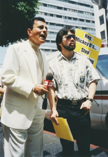 "Casey Kasem and Guy Aoki speak out against KKBT-FM's ""House Party"" in 1995 outside the Hollywood McDonald's."