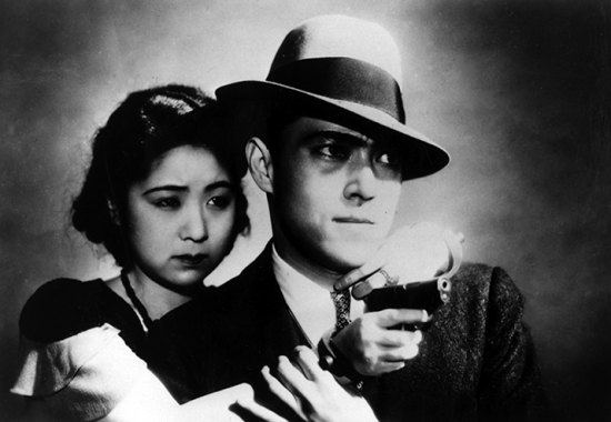 "Kinuyo Tanaka and Joji Oka in ""Dragnet Girl."""
