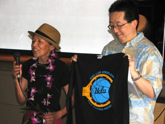 Emma Gee and UCLA Asian American Studies Center Director David K. Yoo with a Yuji Ichioka Memorial Tournament T-shirt.