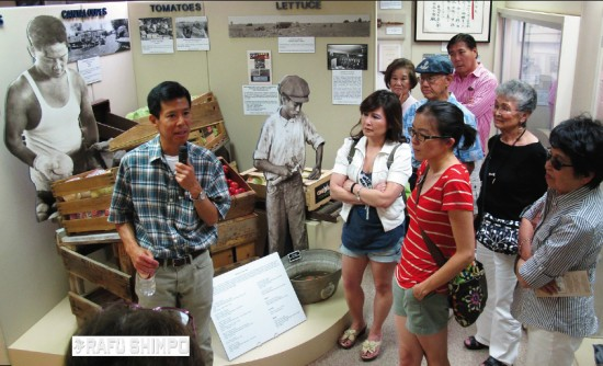 Pioneers Museum Chairman Tim Asamen gives a tour of the museum's Japanese American Gallery.