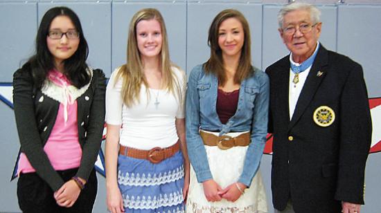 Scholarship recipients Jingwen Yuan, Mckinzey Willis and Jesse Kempkes with Hiroshi Miyamura.