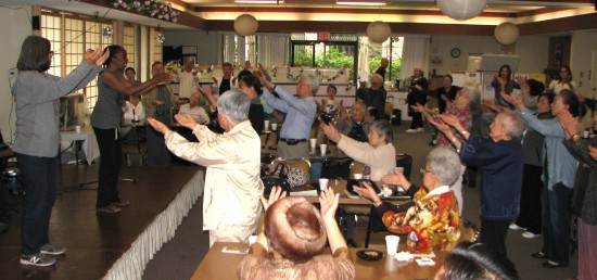 Jacqueline Rice (left), who teaches qi gong at the Far East Lounge, leads a group exercise.