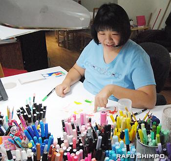 "Hikaru enjoys choosing a color for her new work, ""Little Mermaid."""