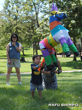 Children enjoyed playing with a pinata.