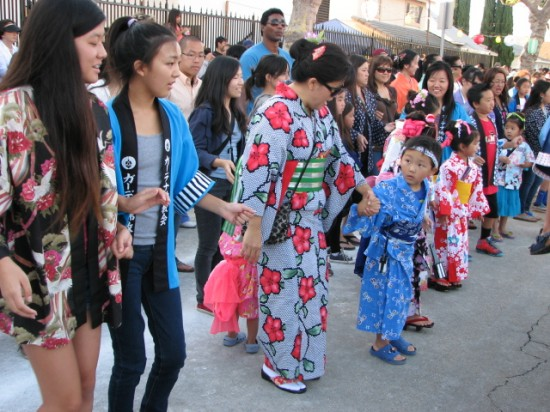 Dancers in last year's Bon Odori at Gardena Buddhist Church. (J.K. YAMAMOTO/Rafu Shimpo)