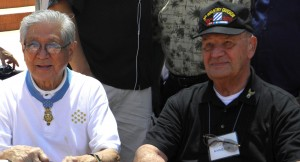 "Hershey Miyamura and lifelong friend Joe Annello signed copies of Vincent Okamoto's book ""Forged in Fire: The Saga of Hershey and Joe"" during Nisei Week in 2012. (J.K. YAMAMOTO/Rafu Shimpo)"