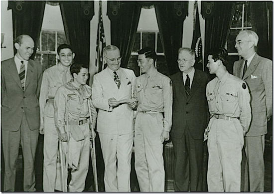 Kelly Kuwayama presenting President Harry Truman with a check contributed by members of the 442nd for the memorial to President Franklin D. Roosevelt on Sept. 11, 1945