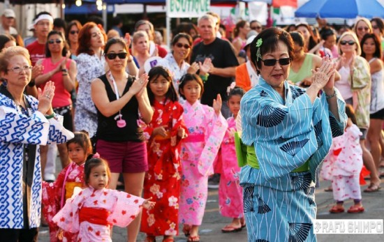 Dance instructor Irene Yamanishi leads many of the attentive dancers through one of the Obon numbers at last year's OCBC Obon Festival. (MARIO G. REYES/Rafu Shimpo)