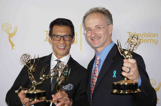 """David Ono and Jeff MacIntyre display some of the five Emmys they won at the 66th annual Los Angeles Area Emmy Awards on Saturday. Ono won two awards for Light News Story-Single Report and Outstanding News Feature Reporting. The pair also won three Emmys for their work on their documentary """"Witness: The Legacy of Heart Mountain,"""" with Ono winning for Outstanding Writer-Programming, and MacIntyre for Outstanding Videographer-Single Camera Programming and Outstanding Editor-Programming.  Photo by Patti Hirahara"""