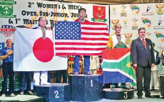Robert Yamasaki listens from the top spot on the podium as the U.S. national anthem is played during an awards ceremony last month at the 2014 International Powerlifting Federation Raw Classic WorldPowerlifting Championship in South Africa. (Photo provided by Robert Yamasaki)